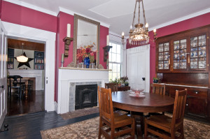 The formal dining room with historic fireplace at 3586 River Road.