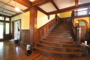 The Great Room is graced with a stair that wraps around the hall.