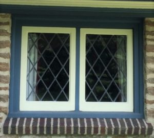 Original casement window, minimal wood trim.