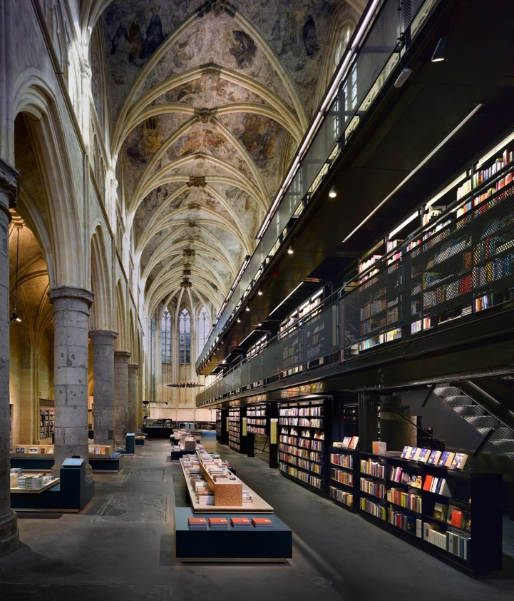 Dutch bookstore chain Selexyz inside of a 13th century Dominican church in Maastricht, Holland. The space maintains the church's architectural structure and design attributes.