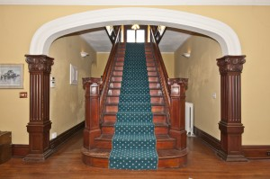 Grand staircase with arch.
