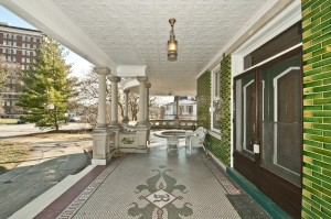 """The mosiac tiled front porch still has the Roth """"R"""" inlay."""