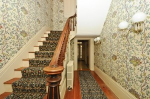 The main staircase and hallway in the farmhouse.