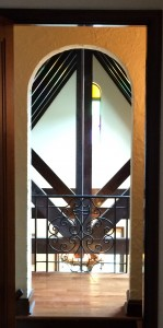 A curved doorway leads to the second floor balcony overlooking the living room--definitely a very cozy feel!