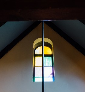 Luminous rounded stained glass window at 700 E. Mitchell Avenue